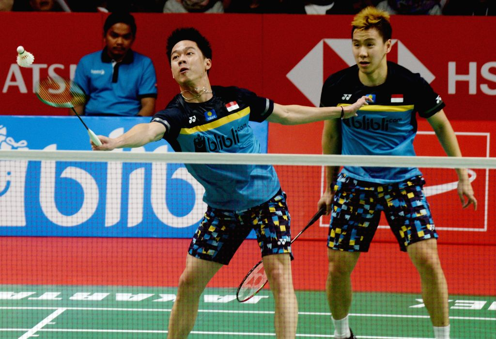 JAKARTA, Jan. 26, 2019 - Kevin Sanjaya Sukamuljo (L) and Marcus Fernaldi Gideon of Indonesia compete during the men's doubles semifinal match against Kim Astrup and Anders Skaarup Rasmussen of ...
