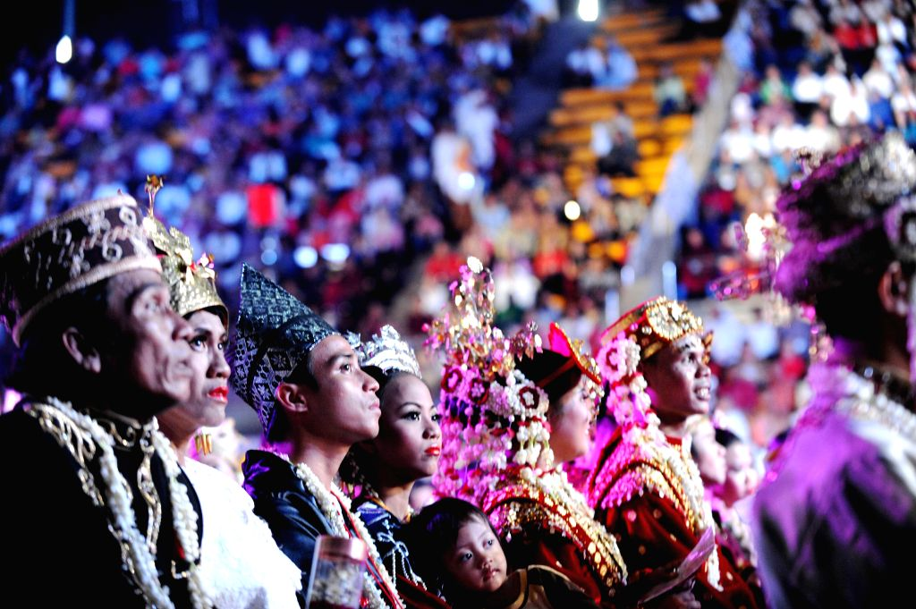 Couples attend a mass wedding in Jakarta, Indonesia, Jan. 28, 2015. More than five thousand couples participated in a mass wedding celebration here on Wednesday. ...