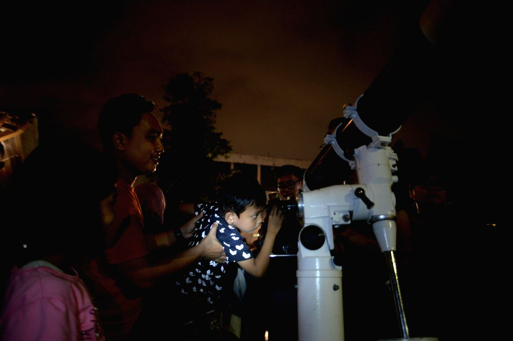"JAKARTA, Jan. 31, 2018 - People queue to watch the ""supermoon"" by a telescope in Jakarta, Indonesia, Jan. 31, 2018."