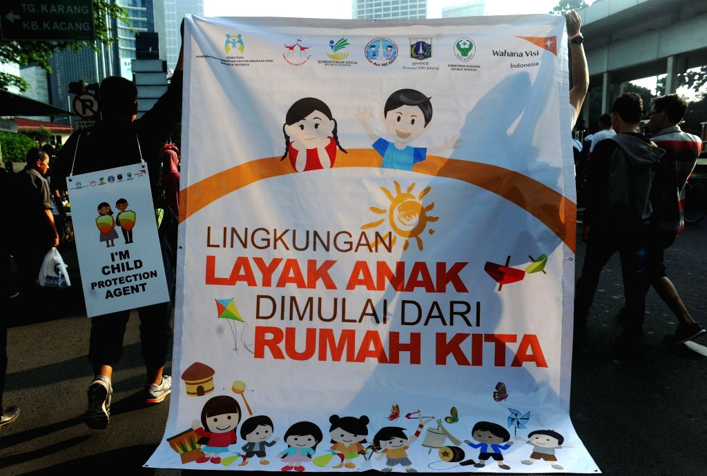 JAKARTA, Jul 24, 2016 - People holding a banner attend a campaign for child protection and anti-violence against children during the commemoration of National Children's Day in Jakarta, Indonesia, ...
