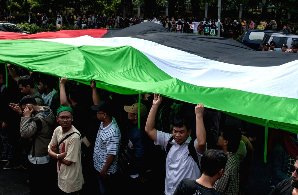 JAKARTA, July 1, 2016 - People from Islamic organizations take part in a rally in front of the U.S. Embassy in Jakarta, Indonesia, during the Al-Quds Day on July 1, 2016. The last Friday of the ...