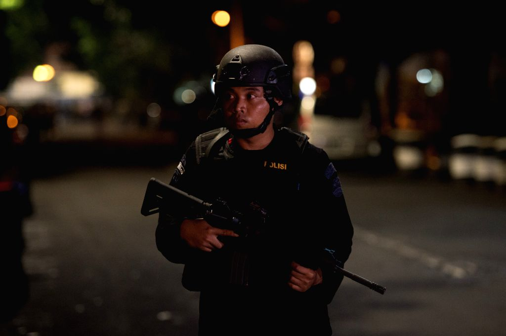 JAKARTA, July 1, 2017 - An armed police stands guard at the scene in South Jakarta, Indonesia, June 30, 2017. A militant on Friday evening stabbed two members of mobile-police brigade in a mosque in ...