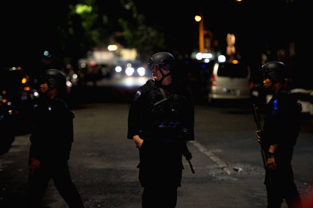 JAKARTA, July 1, 2017 - Armed police stand guard at the scene in South Jakarta, Indonesia, June 30, 2017. A militant on Friday evening stabbed two members of mobile-police brigade in a mosque in ...