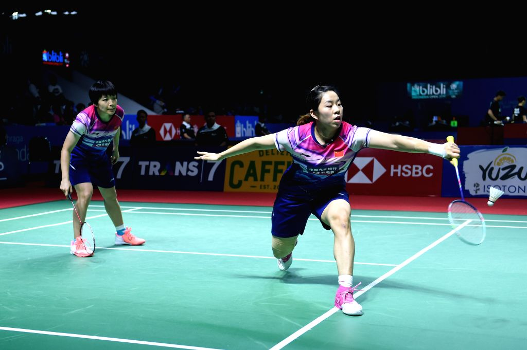 JAKARTA, July 17, 2019 - Chen Qingchen/Jia Yifan (R) of China compete during the women's doubles first round match against Metya Inayah Cindiani/Vania Arianti Sukoco of Indonesia at the Indonesia ...