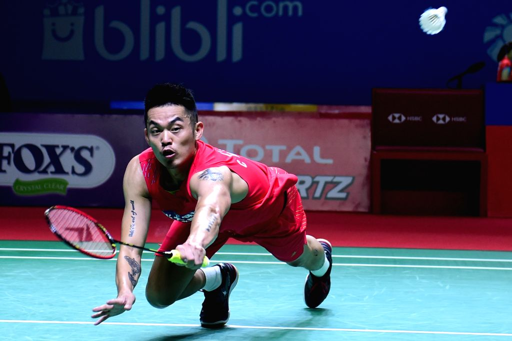 JAKARTA, July 18, 2019 - Lin Dan of China competes during the men's singles second round match between Lin Dan of China and Chou Tien Chen of Chinese Taipei at the Indonesia Open 2019 badminton ...