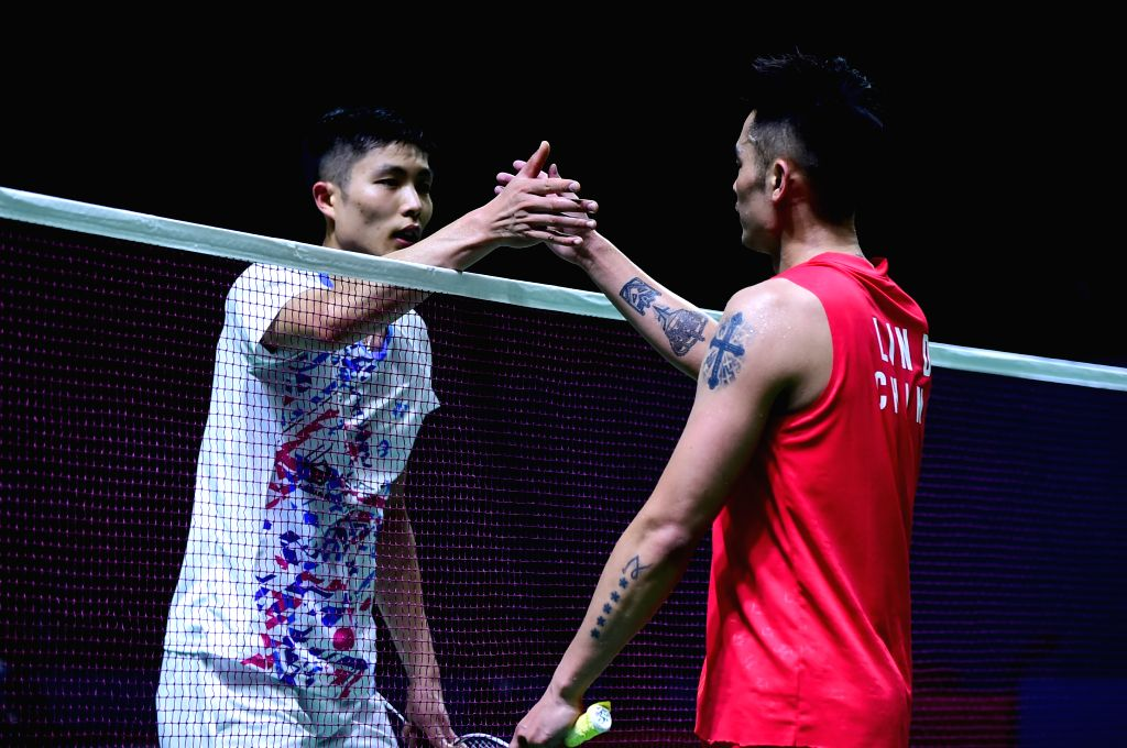 JAKARTA, July 18, 2019 - Lin Dan (R) of China shakes hands with Chou Tien Chen of Chinese Taipei after the men's singles second round match at the Indonesia Open 2019 badminton tournament in Jakarta, ...