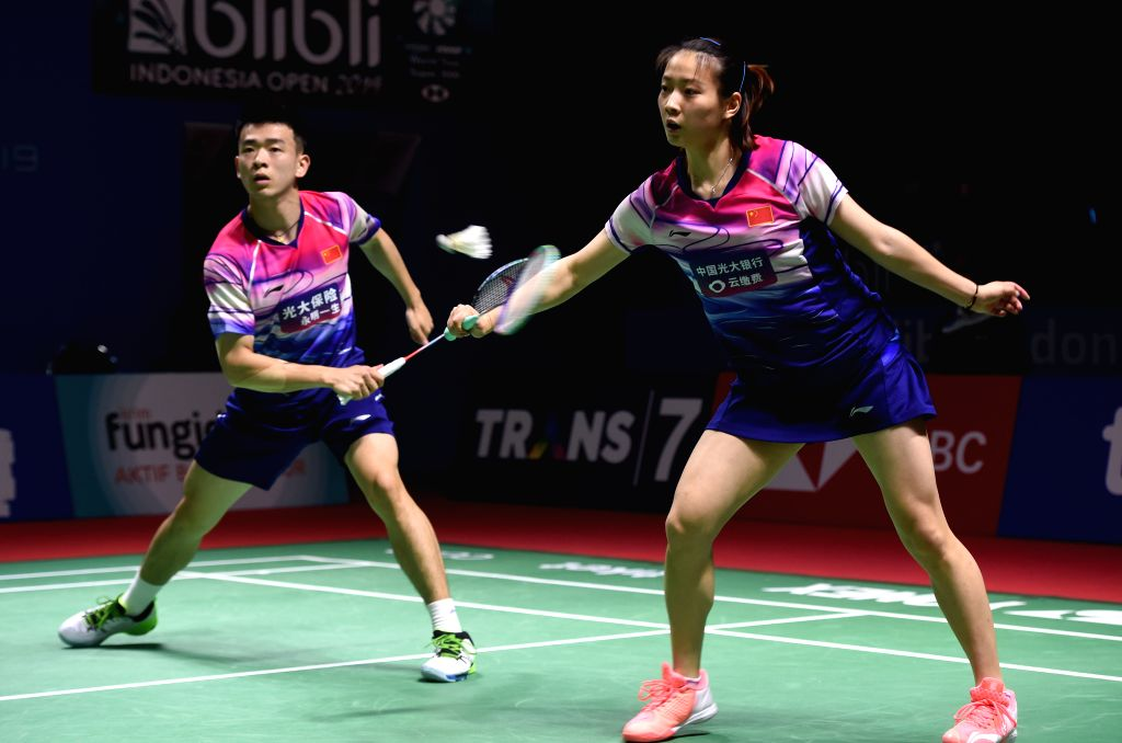 JAKARTA, July 18, 2019 - Zheng Siwei (L)/Huang Yaqiong of China compete during the mixed doubles second round match against Pranaav Jerry Chopra/Reddy N. Sikki of India at the Blibli Indonesia Open ... - Pranaav Jerry Chopra