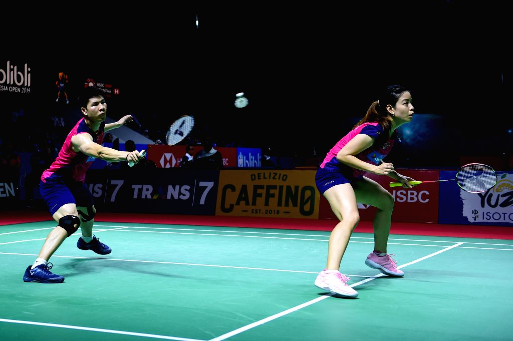 JAKARTA, July 19, 2019 - Goh Soon Huat (L)/Lai Shevon Jemie of Malaysia compete during the mixed doubles third round match between Wang Yilyu/Huang Dongping of China and Goh Soon Huat/Lai Shevon ...