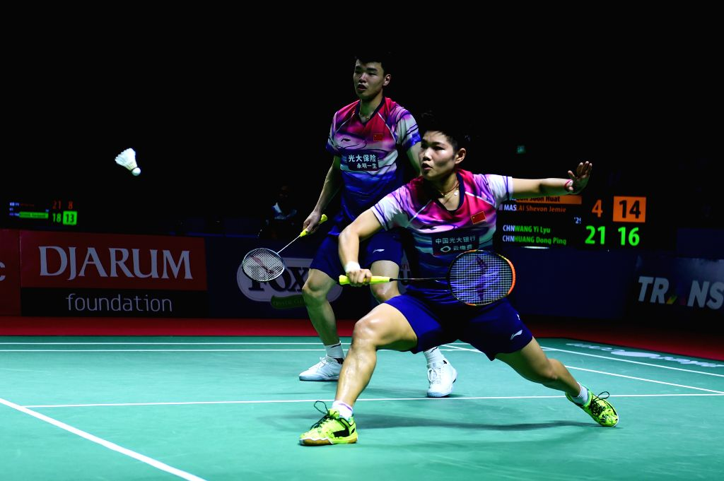 JAKARTA, July 19, 2019 - Wang Yilyu/Huang Dongping (front) of China compete during the mixed doubles third round match between Wang Yilyu/Huang Dongping of China and Goh Soon Huat/Lai Shevon Jemie of ...