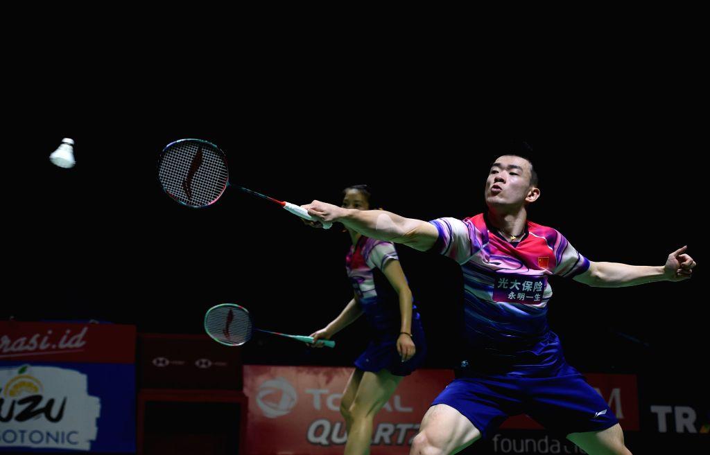 JAKARTA, July 20, 2019 - Zheng Siwei (R)/Huang Yaqiong compete during the mixed doubles semifinals match between Zheng Siwei/Huang Yaqiong of China and Tan Kian Meng/Lai Pei Jing of Malaysia at the ...