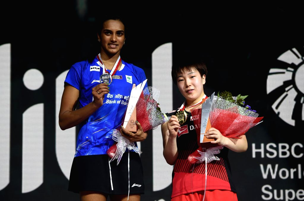 JAKARTA, July 21, 2019 - Akane Yamaguchi (R) and Pusarla V. Sindhu pose on the medal ceremony after the women's singles final match between Yamaguchi Akane of Japan and Pusarla V. Sindhu of India at ...