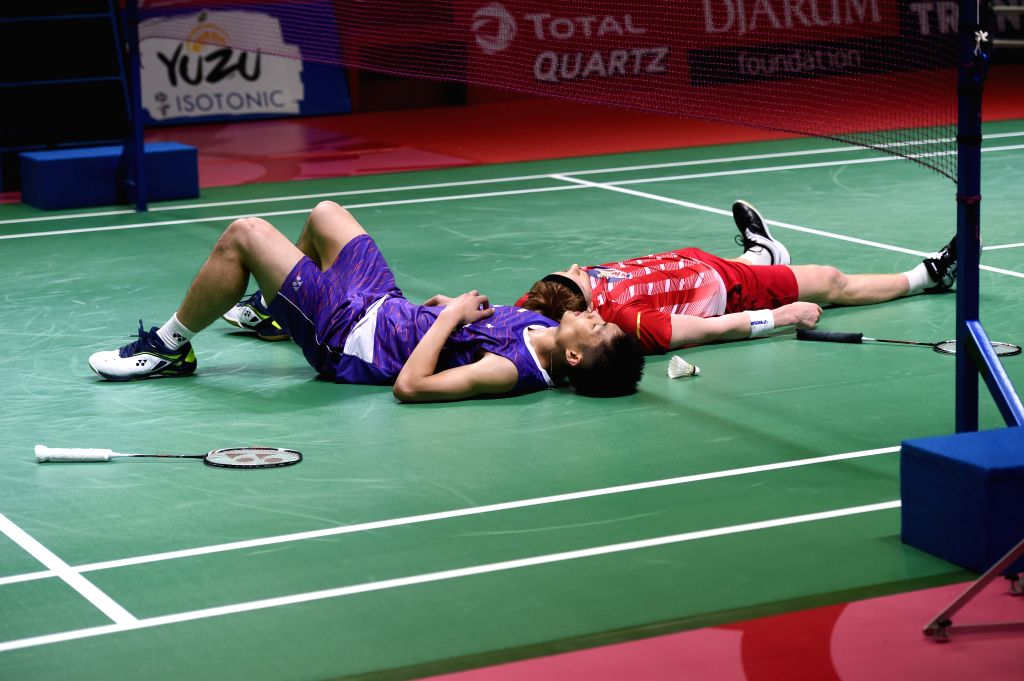 JAKARTA, July 21, 2019 - Chou Tien Chen (L) of Chinese Taipei and Anders Antonsen of Denmark react after the men's singles final match at the Indonesia Open 2019 badminton tournament in Jakarta, ...