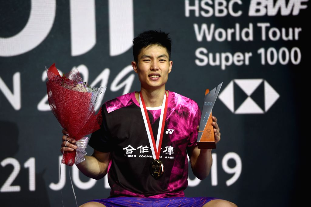 JAKARTA, July 21, 2019 - Chou Tien Chen of Chinese Taipei poses during the medal ceremony after the men's singles final match at the Indonesia Open 2019 badminton tournament in Jakarta, Indonesia, ...