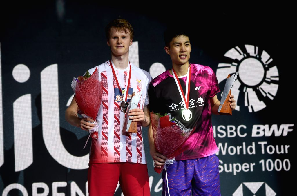 JAKARTA, July 21, 2019 - Chou Tien Chen (R) of Chinese Taipei and Anders Antonsen of Denmark pose during the medal ceremony after the men's singles final match at the Indonesia Open 2019 badminton ...