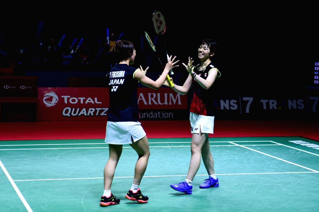 JAKARTA, July 21, 2019 - Fukushima Yuki(L)/Hirota Sayaka celebrate victory after the women's doubles final match between Fukushima Yuki/Hirota Sayaka of Japan and Matsutomo Misaki/Takahashi Ayaka of ...