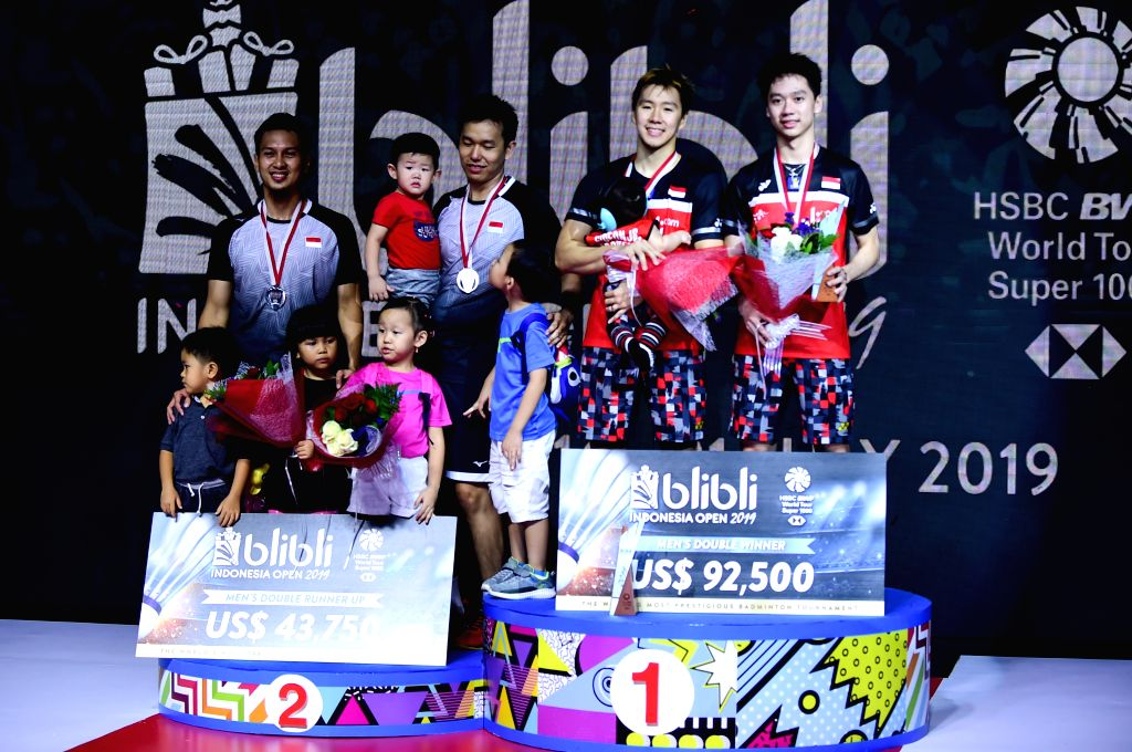 JAKARTA, July 21, 2019 - Gold medalists Marcus Fernaldi Gideon (2nd R)/Kevin Sanjaya Sukamuljo (1st R) and silver medalists Mohammad Ahsan (1st L)/Hendra Setiawan (2nd L) pose on the podium after the ...