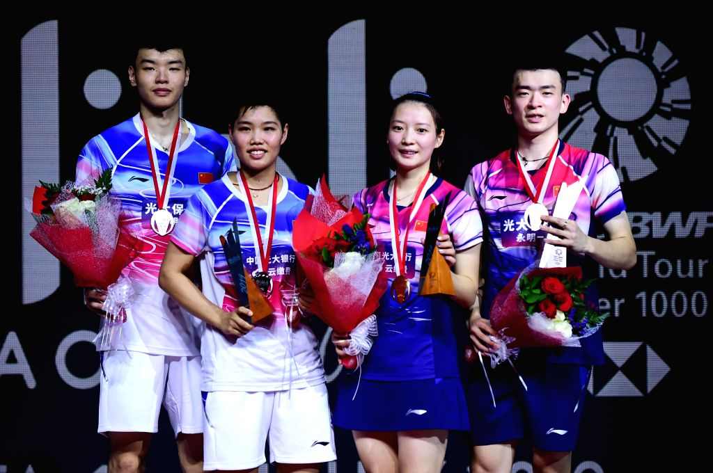 JAKARTA, July 21, 2019 - Gold medalists Zheng Siwei (1st R)/Huang Yaqiong (2nd R) and silver medalists Wang Yilyu (1st L)/Huang Dongping (2nd L) pose on the podium after the mixed doubles final match ...