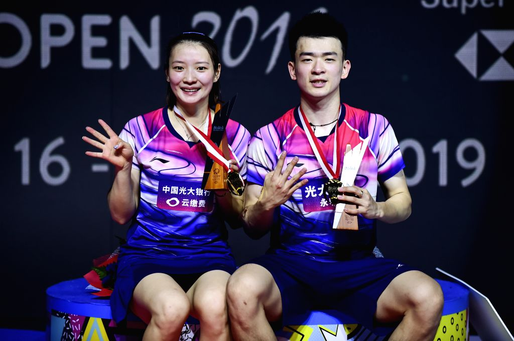 JAKARTA, July 21, 2019 - Gold medalists Zheng Siwei (R)/Huang Yaqiong pose on the podium after the mixed doubles final match between Zheng Siwei/Huang Yaqiong of China and their compatriots Wang ...