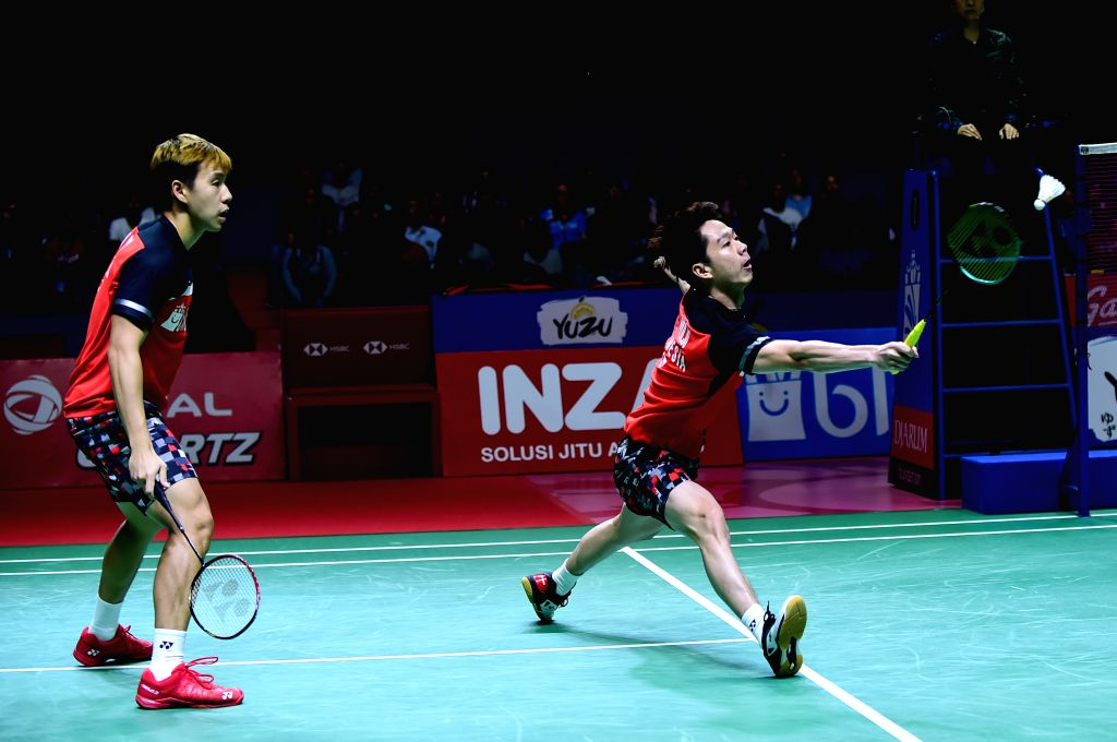 JAKARTA, July 21, 2019 - Marcus Fernaldi Gideon/Kevin Sanjaya Sukamuljo (R) compete during the men's doubles final between Marcus Fernaldi Gideon/Kevin Sanjaya Sukamuljo of Indonesia and their ...