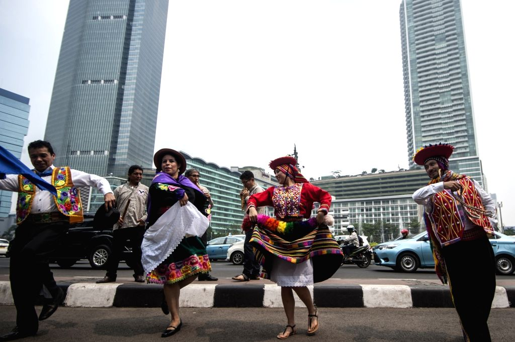 JAKARTA, July 26, 2018 - Peruvian dancers dance on the street during promotion of their culture exhibition in Jakarta, Indonesia, on July 26, 2018. The Peruvian Embassy in Jakarta held for the first ...