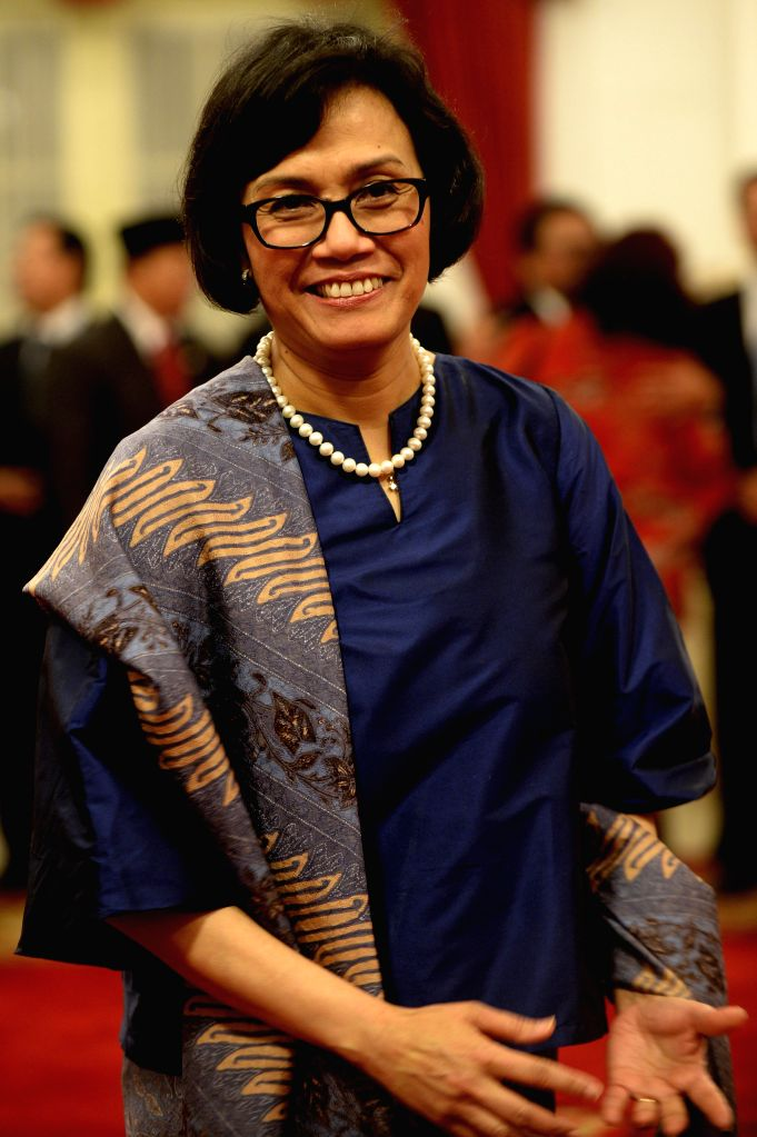 JAKARTA, July 27, 2016 - Indonesia's newly appointed Finance Minister Sri Mulyani Indrawati poses for photos before the inauguration ceremony of new cabinet at the Presidential Palace in Jakarta, ... - Sri Mulyani Indrawati