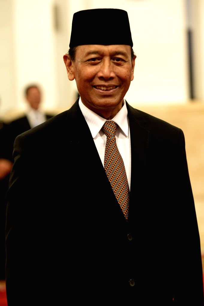 JAKARTA, July 27, 2016 - Indonesia's newly appointed Coordinating Minister for Legal, Politics and Security Affairs Wiranto poses for photos before the inauguration ceremony of new cabinet at the ...