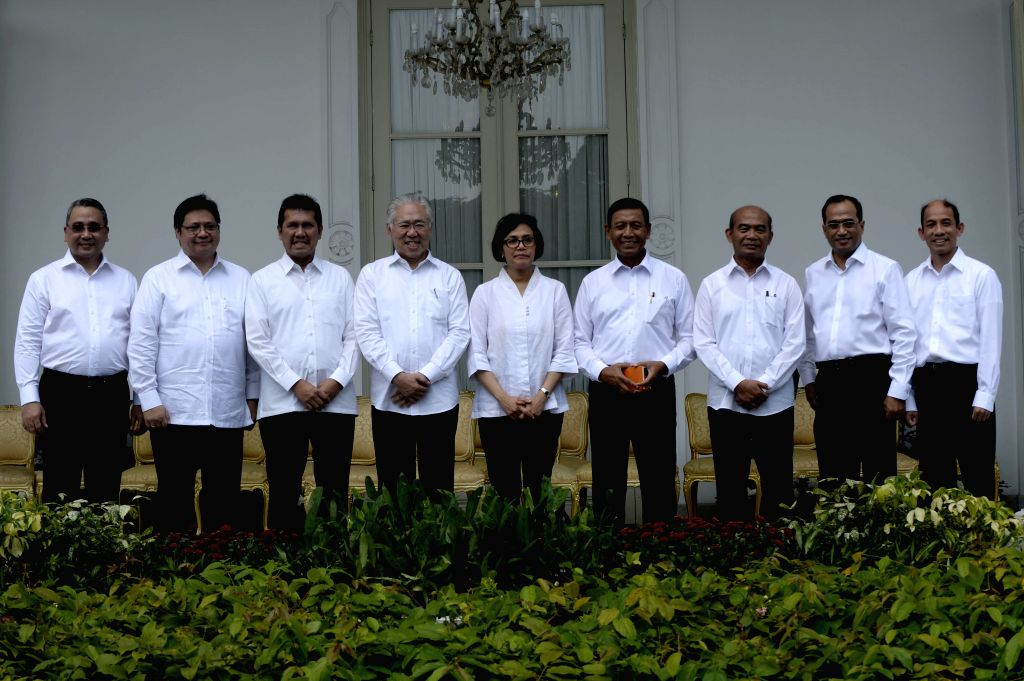 JAKARTA, July 27, 2016 - Indonesian new ministers pose for photos after Indonesian President Joko Widodo and Vice President Jusuf Kalla have announced new cabinet at Presidential Palace in Jakarta, ...