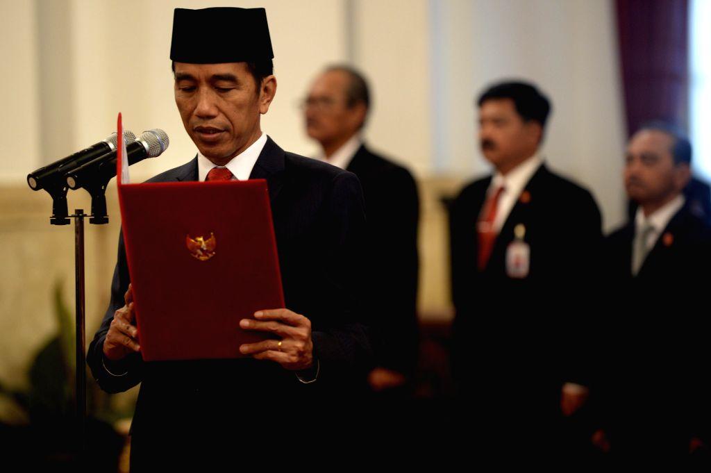 JAKARTA, July 27, 2016 - Indonesian President Joko Widodo addresses the inauguration ceremony of new cabinet at the Presidential Palace in Jakarta, Indonesia, on July 27, 2016. Indonesian President ...