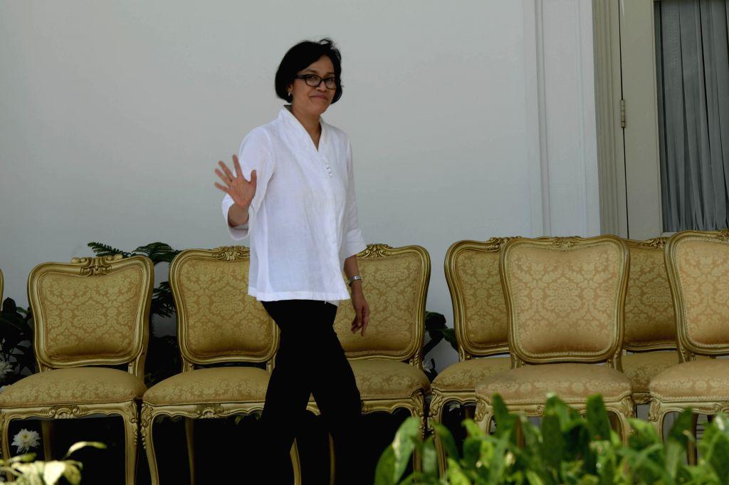 JAKARTA, July 27, 2016 - New Indonesian Finance Minister Sri Mulyani waves to journalists after Indonesian President Joko Widodo and Vice President Jusuf Kalla have announced new cabinet at ... - Sri Mulyani