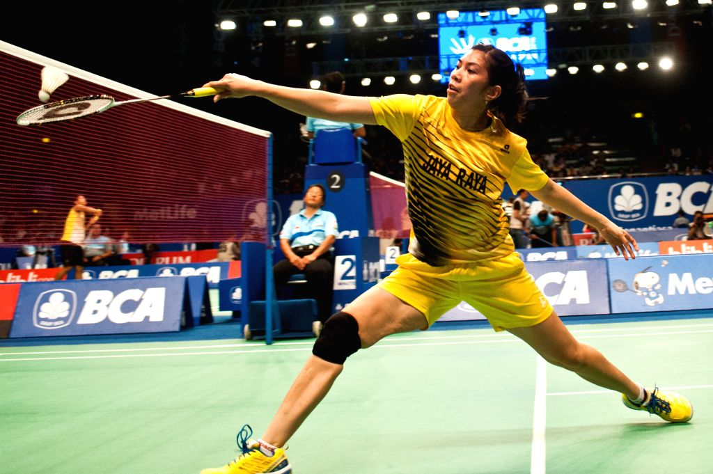 Adrianti Firdasari of Indonesia returns the shuttlecock to Yulia Yosephin Susanto of Indonesia during the qualification round two at BCA Indonesia Open 2014 at ...
