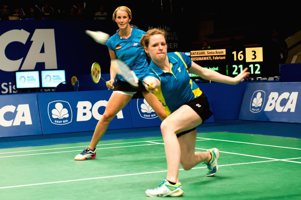 Birgit Michels (L) and Isabel Herttrich of Germany return the shuttlecock to Sinta Arum Antasari and Febriani Endar Kusumawati of Indonesia during qualification ...