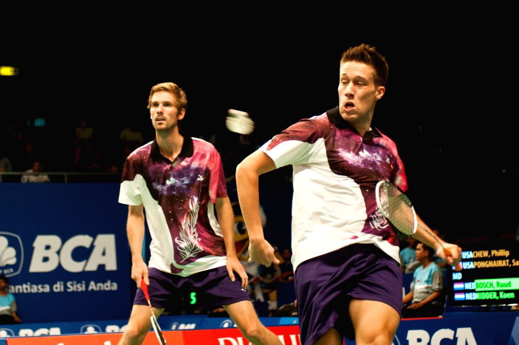 Koen Ridder (R) and Ruud Bosch of the Netherlands return the shuttlecock to Phillip Chew and Sattawat Pongnairat of the U.S. during qualification round one at BCA ..