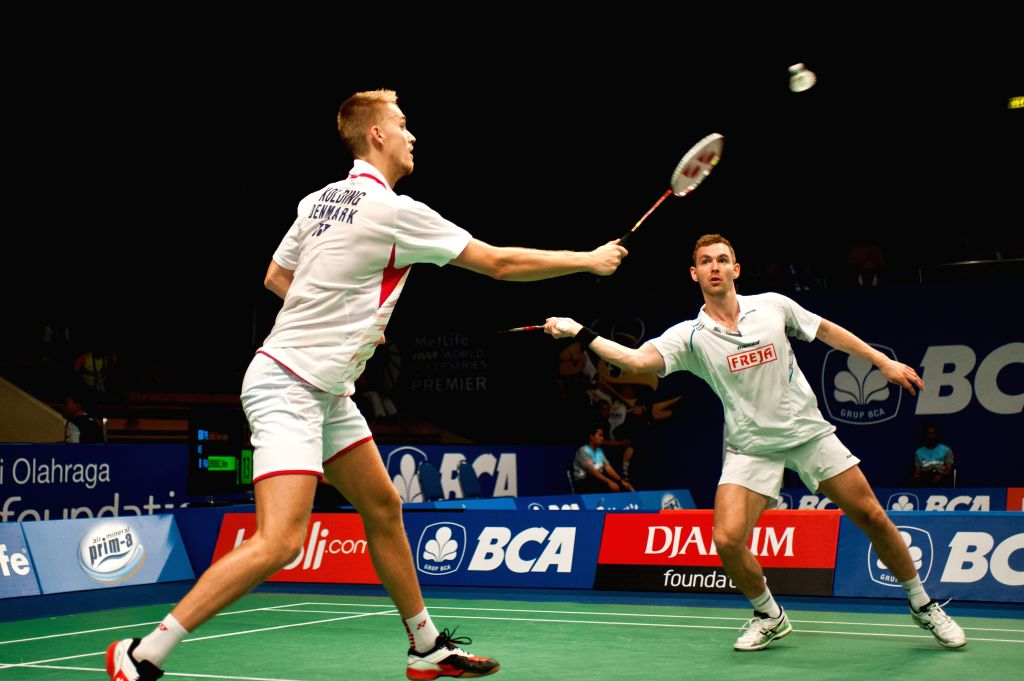 Kolding M. P. (L) and Mads Conrad-Petersen of Denmark compete during round one of BCA Indonesia Open 2014 against Mohammad Ahsan and Hendra Setiawan of Indonesia at