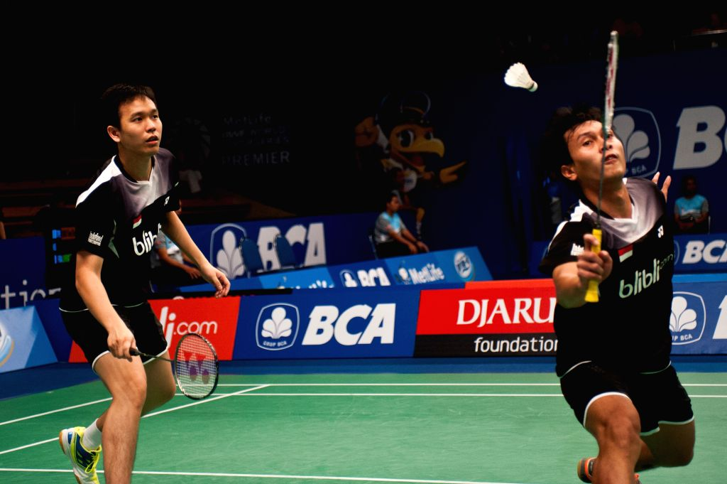 Mohammad Ahsan (R) and Hendra Setiawan of Indonesia compete during round one of BCA Indonesia Open 2014 against Kolding M. P. and Mads Conrad-Petersen of Denmark at