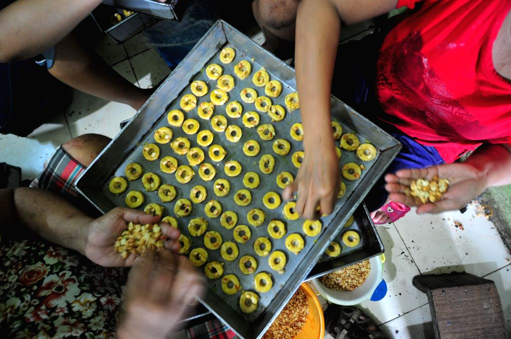 JAKARTA, June 23, 2016 - Indonesian workers make cakes during the holy month of Ramadan in Jakarta, Indonesia, June 23, 2016. The demand of cakes usually surge ahead of Eid al-Fitr at the end of ...
