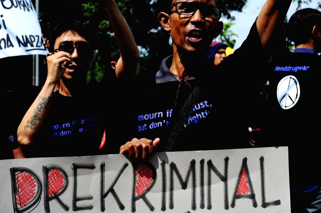 JAKARTA, June 24, 2016 - Former drug addicts holding placards attend a rally to call for the end of the drug war during the commemoration of the International Day Against Drug Abuse and Illicit ...