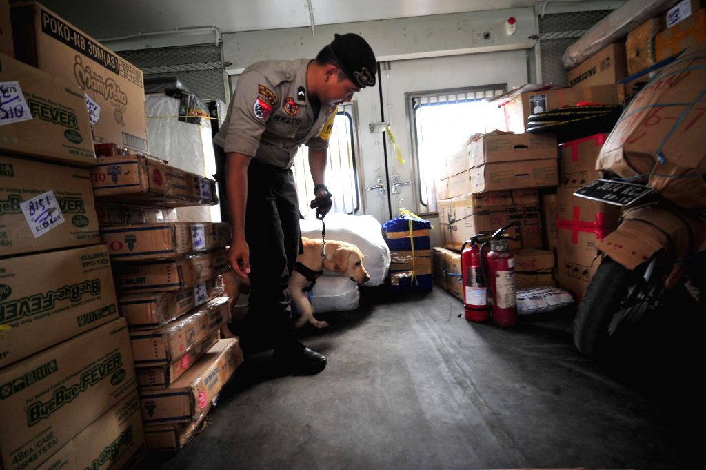 JAKARTA, June 29, 2016 - An Indonesian policeman inspects a cargo railway carriage at a train station in Jakarta, Indonesia, June 29, 2016. Muslims across Indonesia move from major cities to their ...
