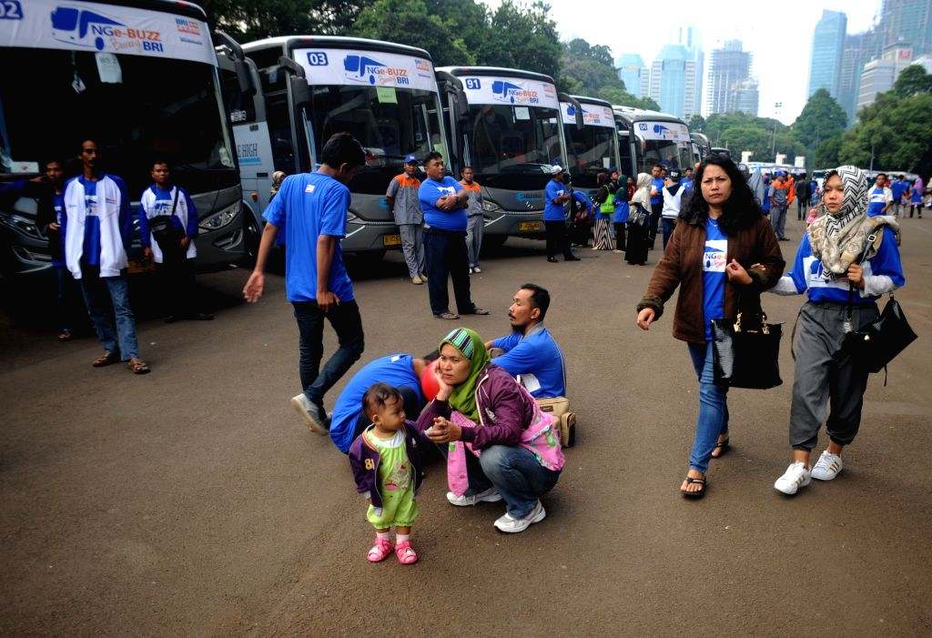 JAKARTA, June 29, 2016 - Passengers wait to board free-of-charge buses provided by a national bank to their hometowns in Jakarta, capital of Indonesia, June 29, 2016. Each year Indonesia's traffic ...