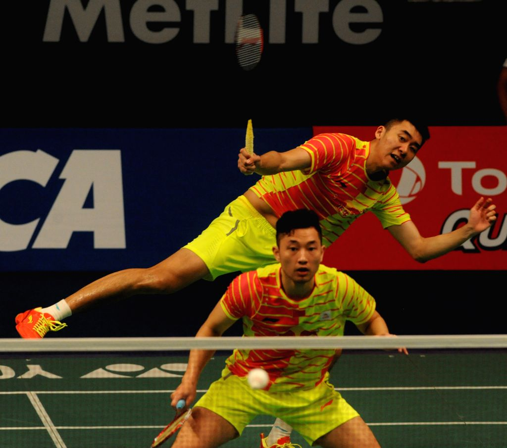 JAKARTA, June 4, 2016 - Chai Biao (front) and Hong Wei of China compete during the men's double semifinal match against Mads Conrad Petersen and Mads Pieler Kolding of Denmark at the BCA Indonesia ...