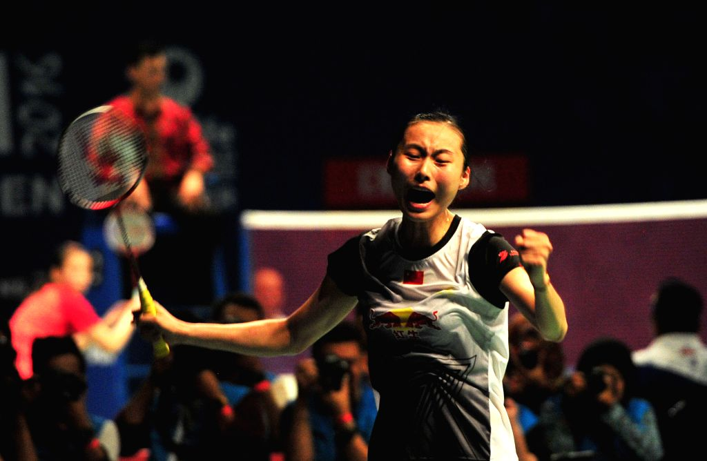 JAKARTA, June 4, 2016 - Wang Yihan of China celebrates after winning the women's singles semifinal against Carolina Marin of Spain at the BCA Indonesia Open 2016 in Jakarta, Indonesia, June 4, 2016. ...