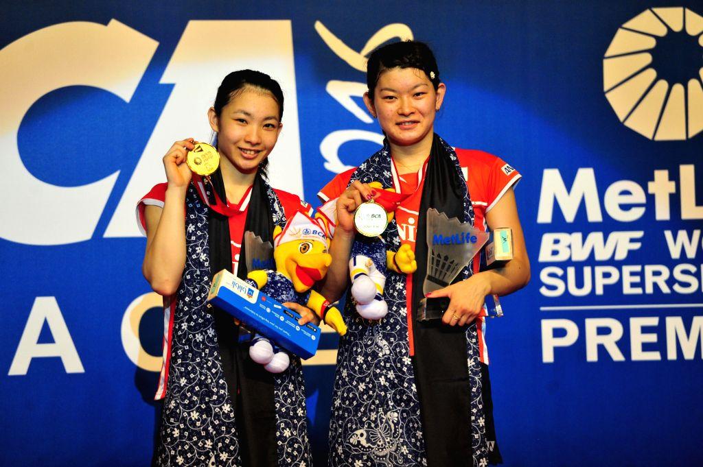 JAKARTA, June 5, 2016 - Misaki Matsutomo (L) and Ayaka Takahashi of Japan pose at their awarding ceremony at the BCA Indonesia Open 2016 in Jakarta, Indonesia, June 5, 2016. Misaki Matsutomo and ...