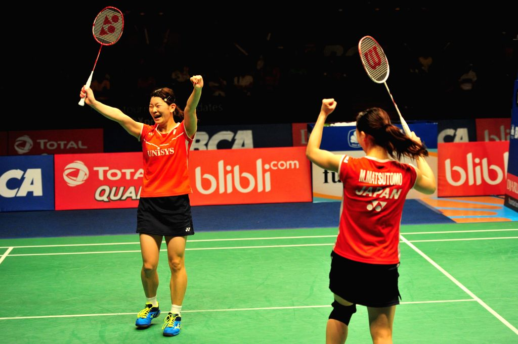 JAKARTA, June 5, 2016 - Misaki Matsutomo (R) and Ayaka Takahashi of Japan celebrate during their women's doubles final match against Tang Yuanting and Yu Yang of China at the BCA Indonesia Open 2016 ...