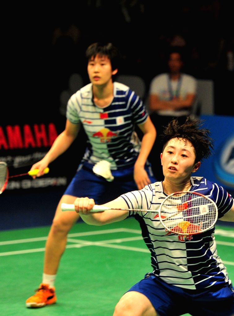 JAKARTA, June 5, 2016 - Tang Yuanting and Yu Yang (front) of China compete during their women's doubles final match against Misaki Matsutomo and Ayaka Takahashi of Japan at the BCA Indonesia Open ...