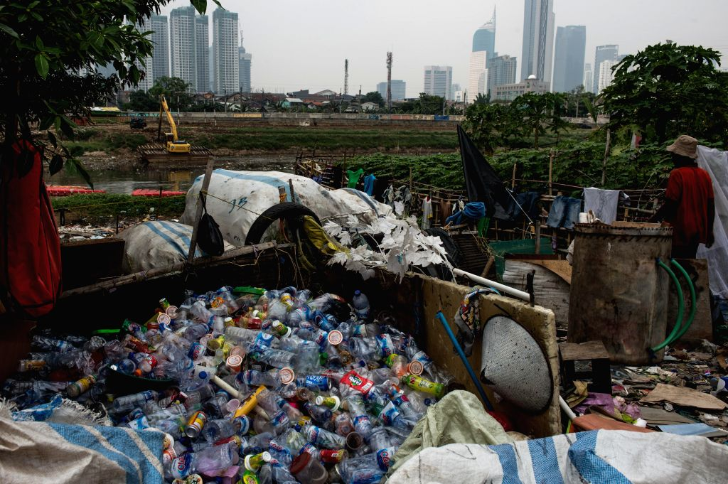 JAKARTA, June 5, 2018 - Photo taken on June 5, 2018 shows Plastic trash bottles on the river bank in Jakarta, Indonesia. World Environment Day falls on Tuesday.
