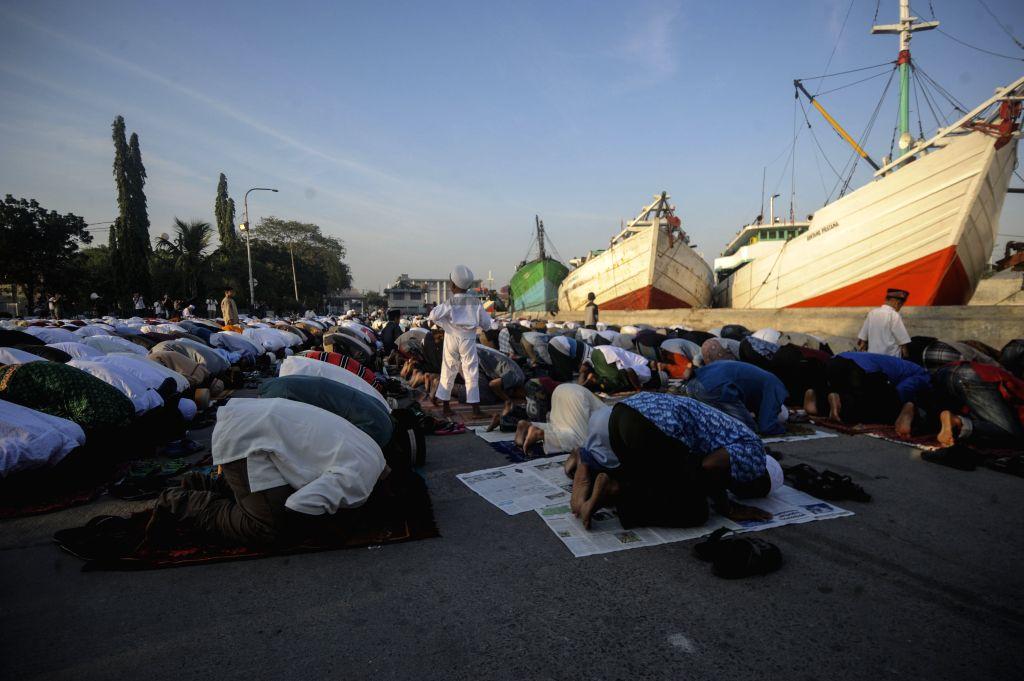 JAKARTA, June 5, 2019 - Muslims participate in Eid al-Fitr praying at Sunda Kelapa port in Jakarta, Indonesia, June 5, 2019.