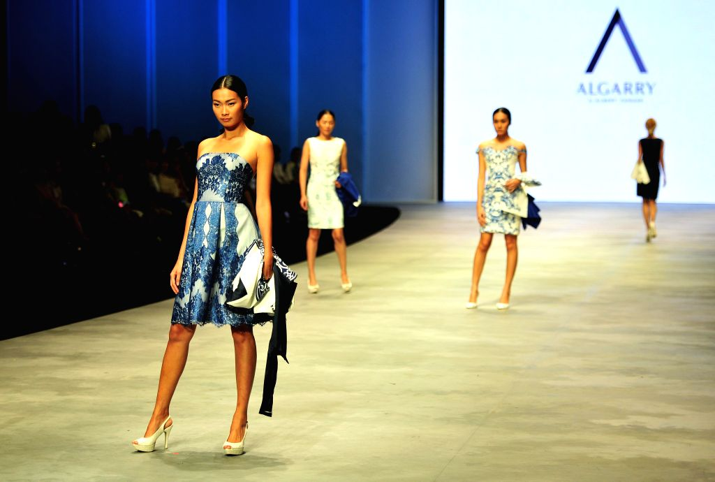Models present creations by Indonesian designer Albert Yanuar during the Indonesian Fashion Week 2015 in Jakarta, Indonesia, Feb. 28, 2015. Indonesian Fashion Week ...