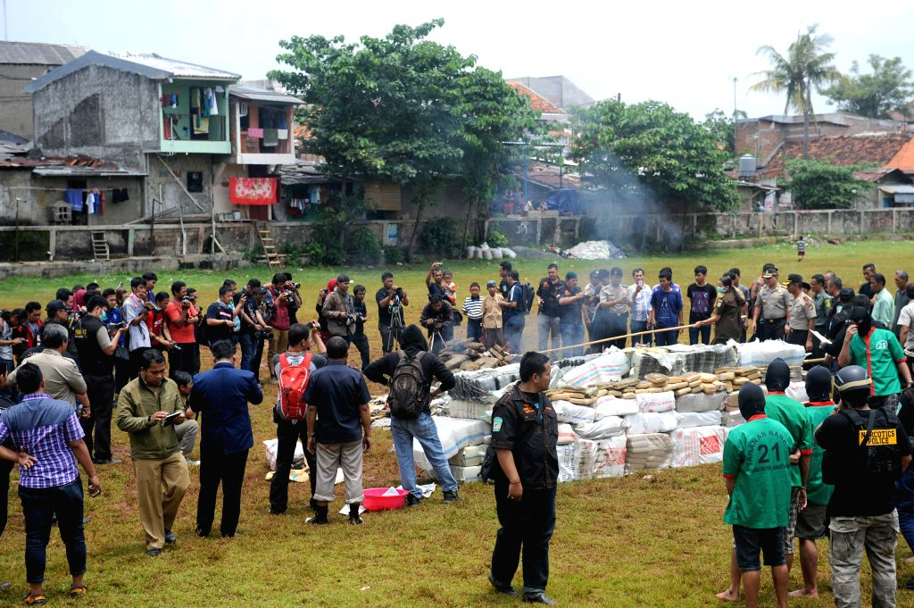 Confiscated drugs are burnt in West Jakarta, Indonesia, March 11, 2015. Indonesian narcotic police officers destroyed 3.3 tons of marijuana, 1834 grams of ...
