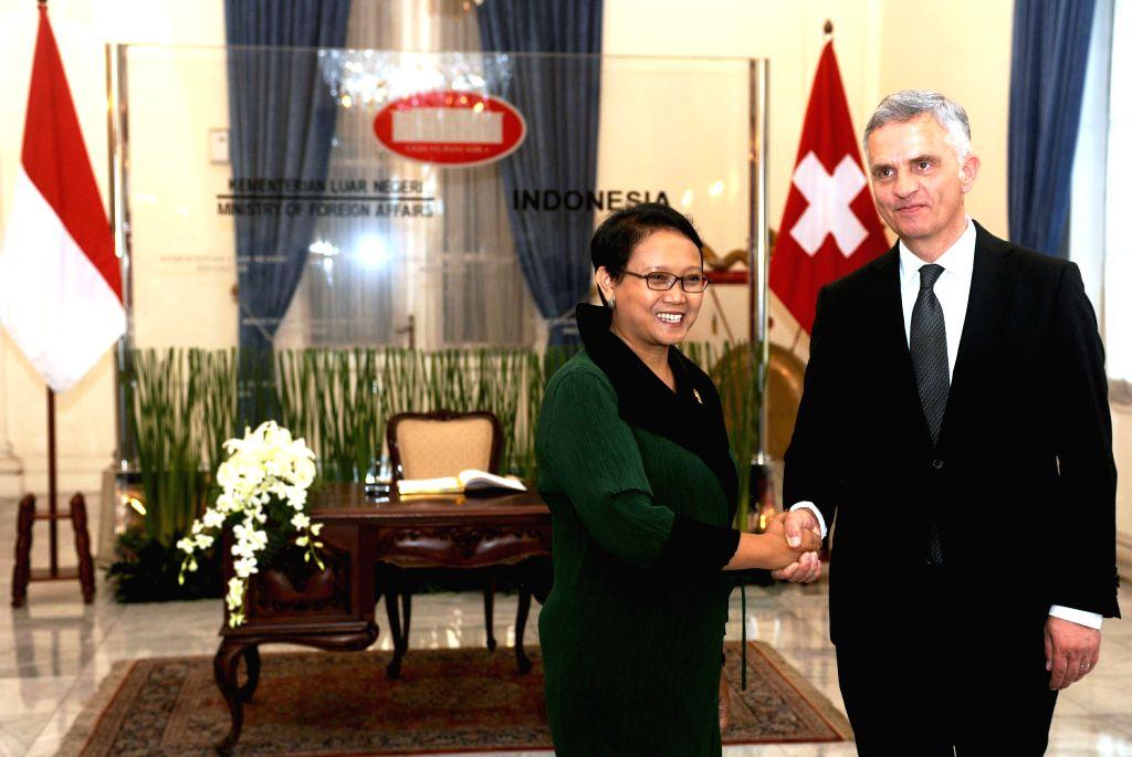 Indonesian Foreign Minister Retno Marsudi (L) shakes hands with her Swiss counterpart Didier Burkhalter in Jakarta, Indonesia, March 16, 2015. Retno Marsudi met ... - Retno Marsudi