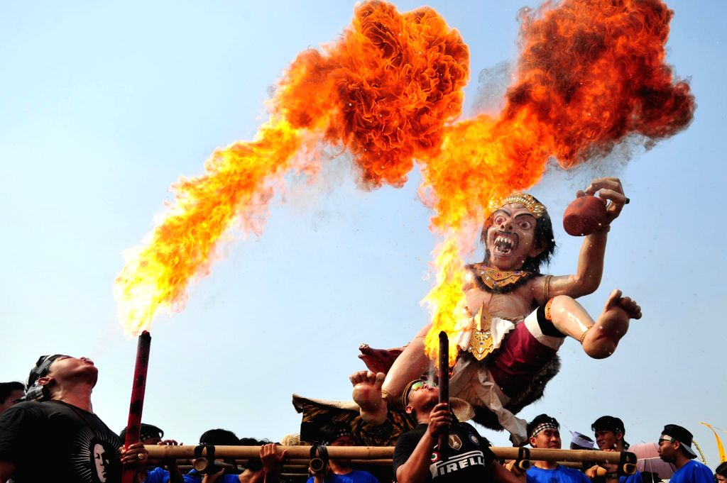 "An effigy locally called ""Ogoh-ogoh"" is seen during a parade one day before Nyepi Day, or ""Day of Silence"", in Jakarta, Indonesia, March 20, ..."
