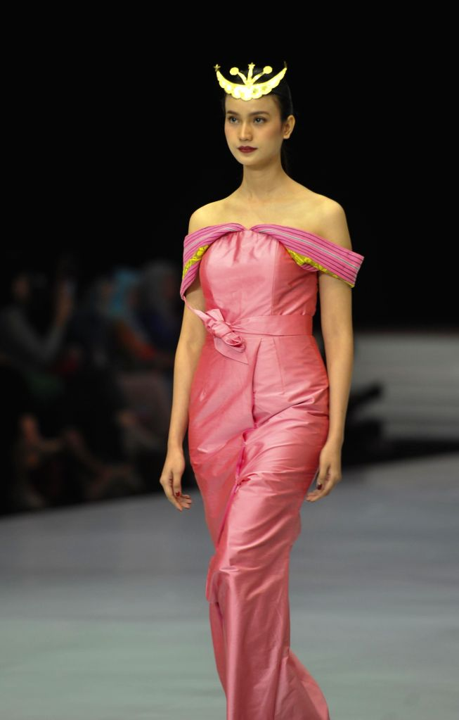 JAKARTA, March 28, 2018 - A model presents a creation by Indonesian designer Adinda Moeda during the first day of the Indonesia Fashion Week in Jakarta, Indonesia, March, 28. 2018.